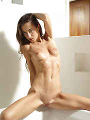 Fresh nude girl solo posing