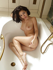 Teen girl ejoying hersel in the bathroom